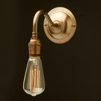Antiqued brass coventry bend wall sconce