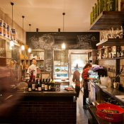 Grossi cafe Ombra using cage wall lamps