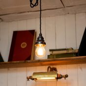 Soho Grind pendants and brass picture lights