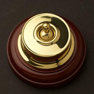 Federation Brass single light switch on optional timber blockFederation Brass single light switch