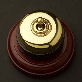 Traditional Brass and porcelain single light switch on optional timber block