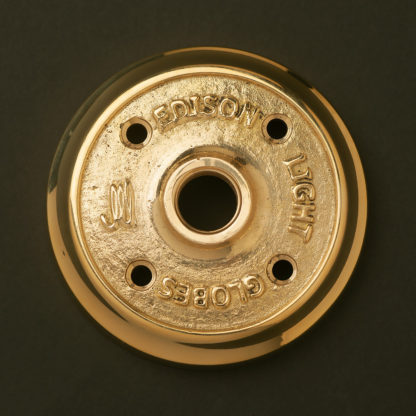 Polished cast brass flange plate