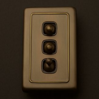 Traditional Antique Brass large plate triple rocker switch