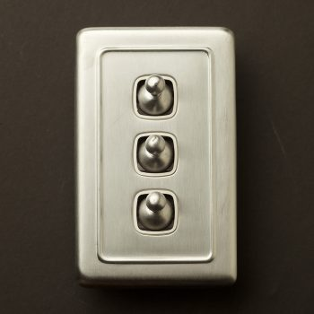 Traditional satin chrome large plate triple rocker switch