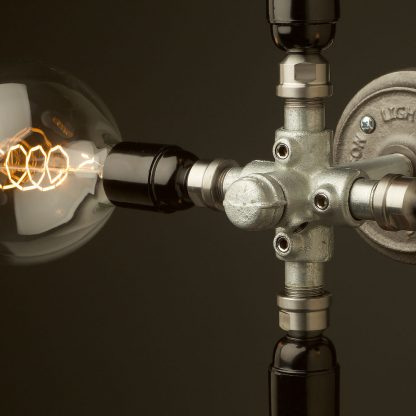 Propeller style 4 bulb pipe hub wall light close up