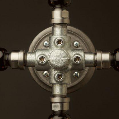 Propeller style 4 bulb pipe hub wall light hub detail
