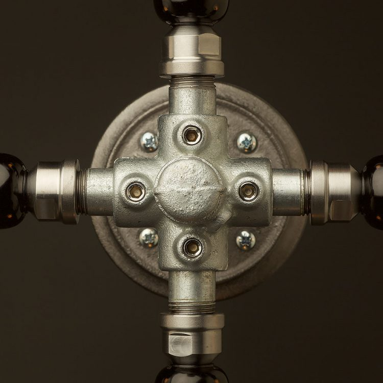 Propeller style 4 bulb pipe hub wall light