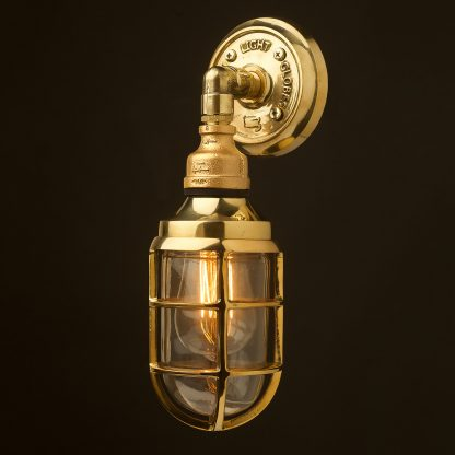 Outdoor brass and plumbing pipe bunker cage wall light