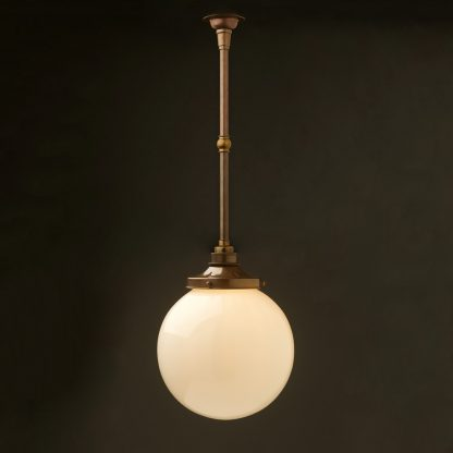 Spherical opal glass brass fixed rod light antique brass