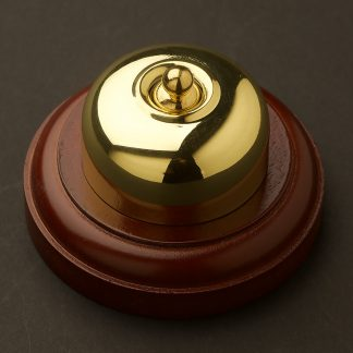 Traditional Polished brass single light switch on optional timber block