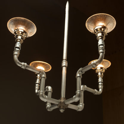 Plumbing Pipe 4 bulb formal chandelier galvanised and glass shade
