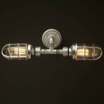 Outdoor aluminium and plumbing pipe twin bunker cage wall light