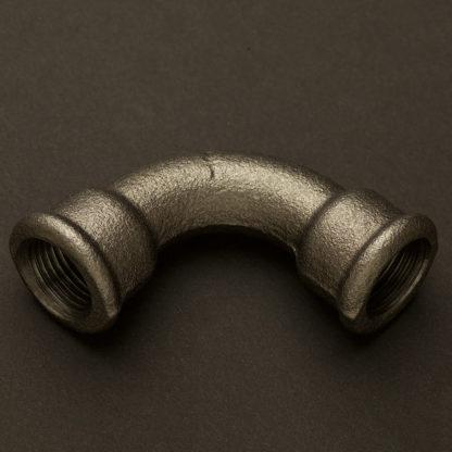 Half inch plumbing pipe bend raw black steel